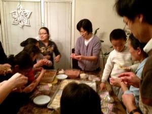 Learning to make Chinese dumplings with Phemie and Bridge International.
